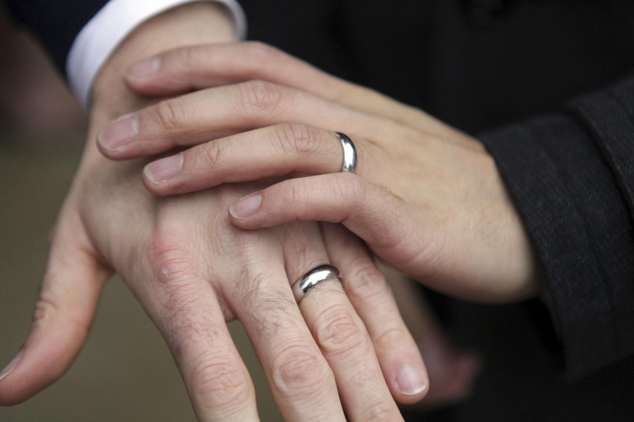 A couple show their rings after getting married outside Seattle City Hall in Seattle, Washington in this file photo taken December 9, 2012.