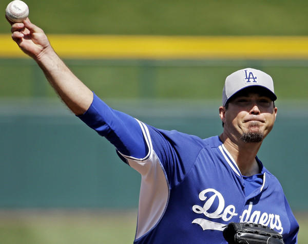 Dodgers pitcher Josh Beckett warms up before an exhibition game against the Chicago Cubs in March.
