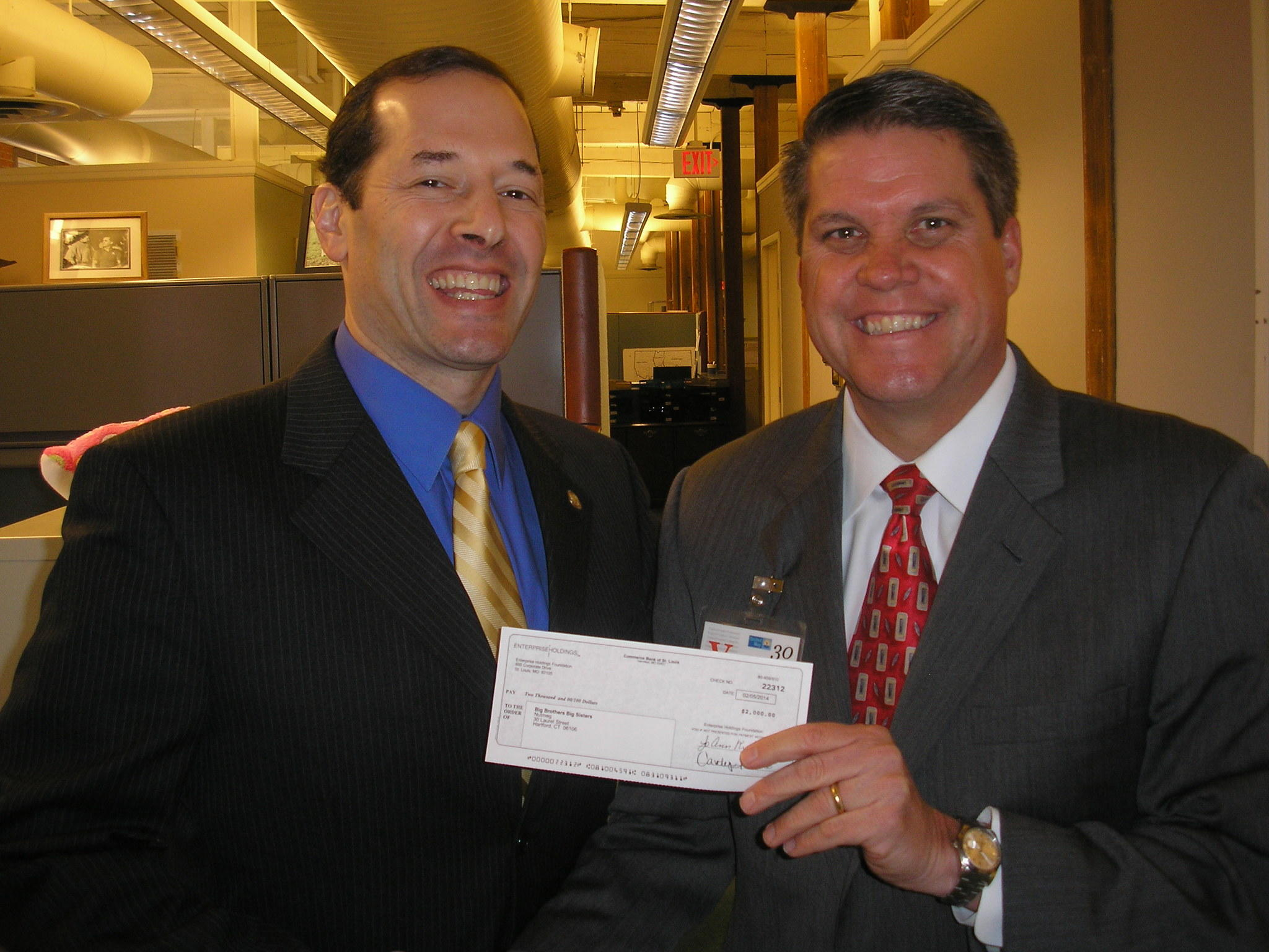 At the donation presentation were, from left, Andy Fleischmann, Nutmeg's president & CEO; and Avon's Larry Kucharski, vice president/general manager of Enterprise Holdings.