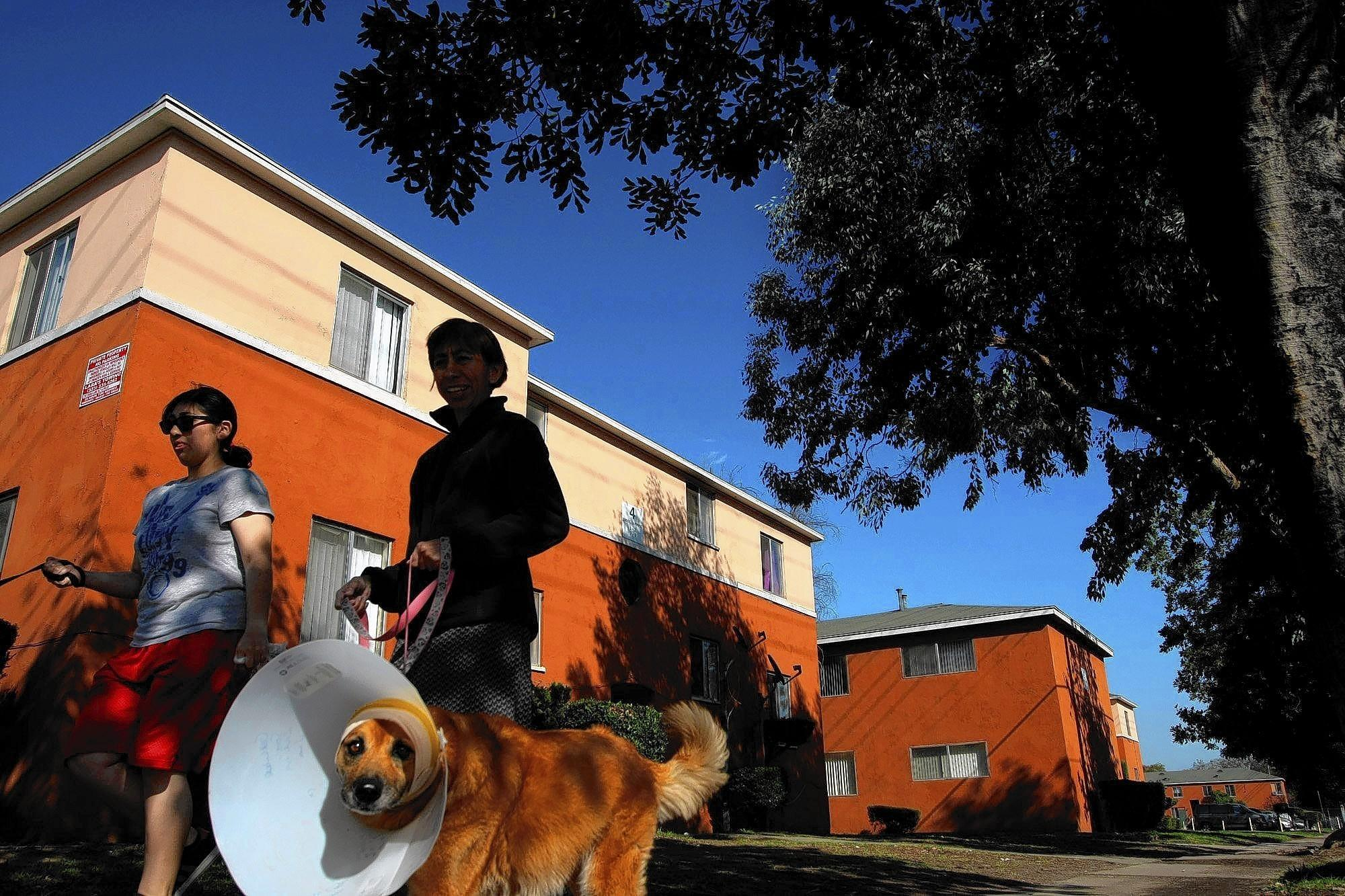 Women walk dogs in front of the Wyvernwood Garden Apartments in Boyle Heights. Built in 1939 and home to about 6,000 residents, the property is one of several considered endangered by the L.A. Conservancy.