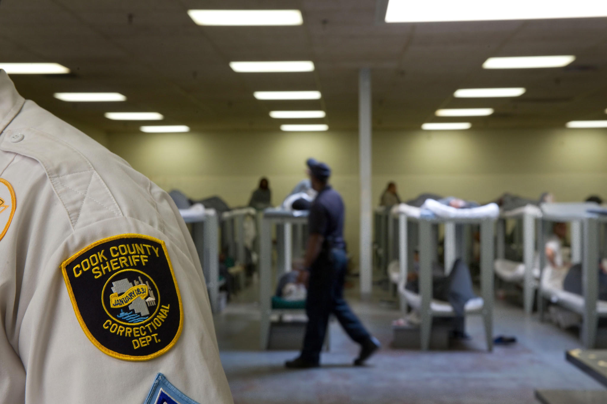 Hundreds of inmates sleep together on bunks in a large room of the Cook County Jail in 2013.