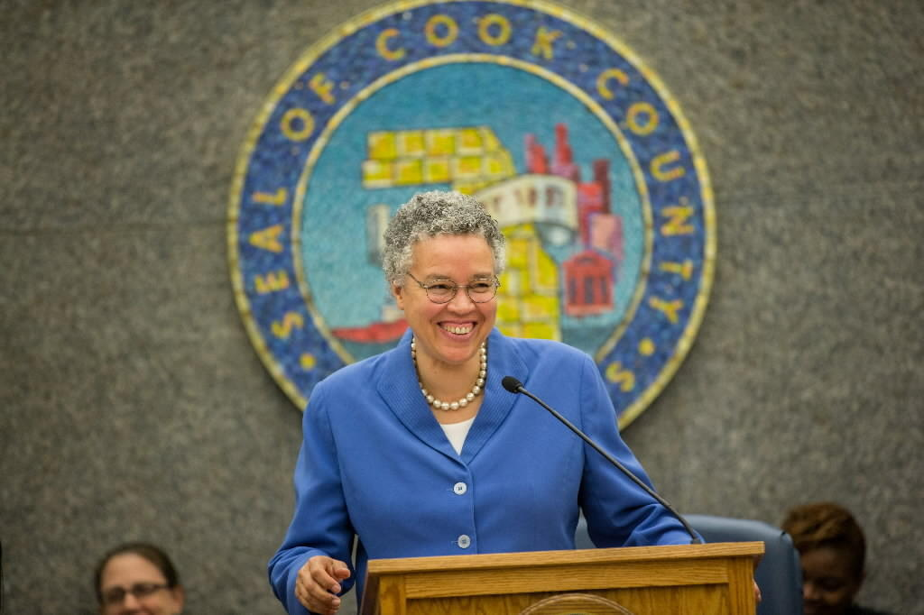 Cook County Board President Toni Preckwinkle smiles after the Cook County Board unanimously passed her $3.2 billion 2014 budget during a special meeting in Chicago on Nov. 8, 2013.