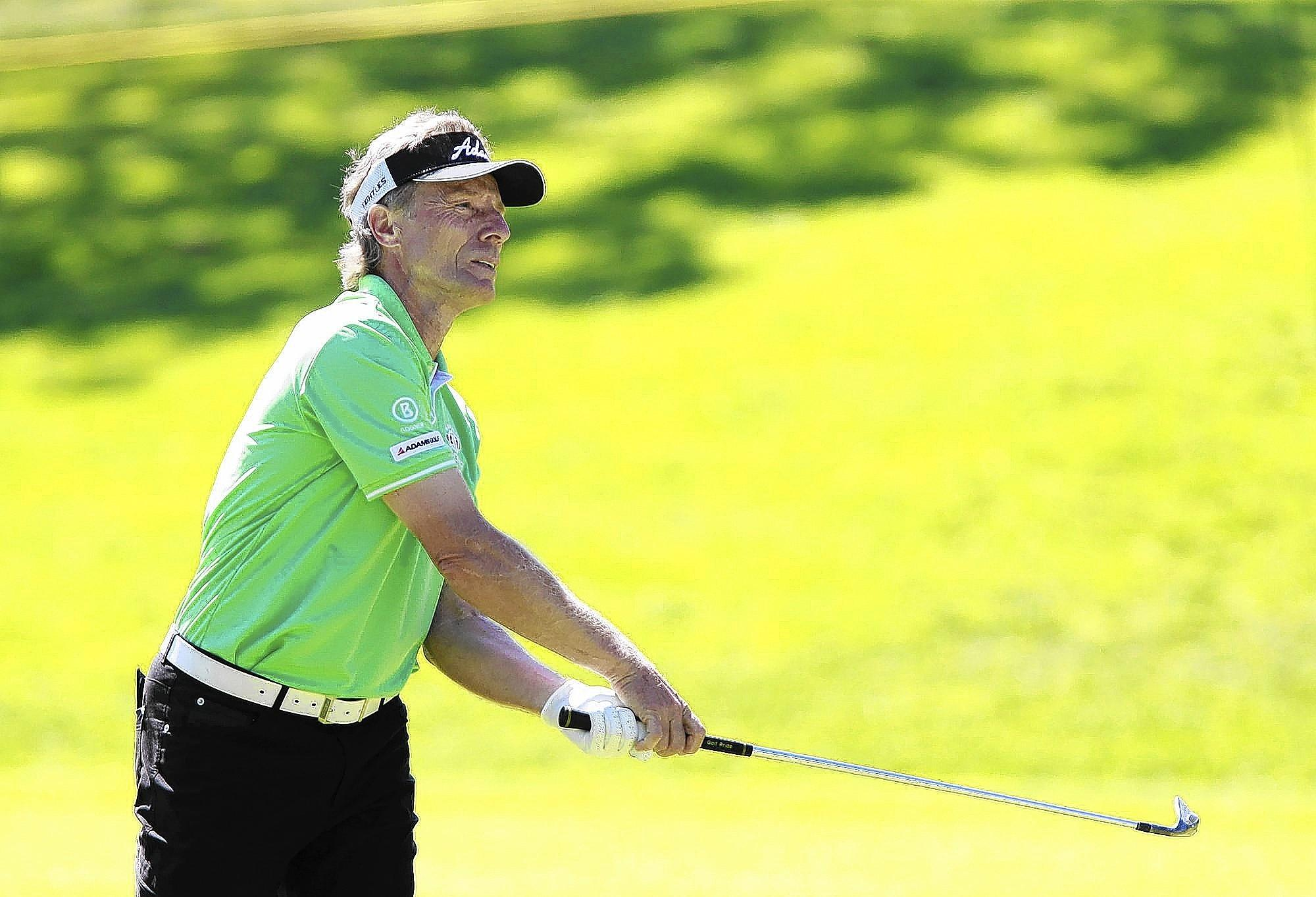 First-round leader Bernhard Langer hits an approach shot on seventh hole during the first round of the Toshiba Classic at the Newport Beach Country Club on Friday.