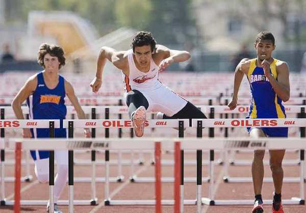 Huntington's Ramon Vargas finishes first in the 100-meter hurdles with 14:74 during a Sunset League meet at Huntington Beach High School on Wednesday.