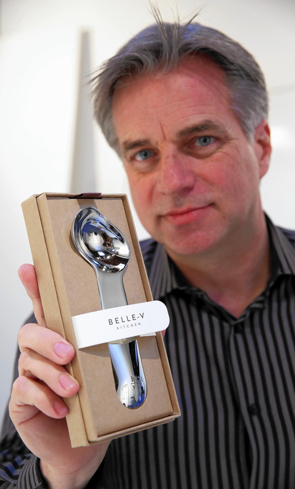 Mark Dziersk, managing director of Lunar, holds the Belle-V ice cream scoop that his company designed and that will be featured at the International Home and Housewares Show at McCormick Place.