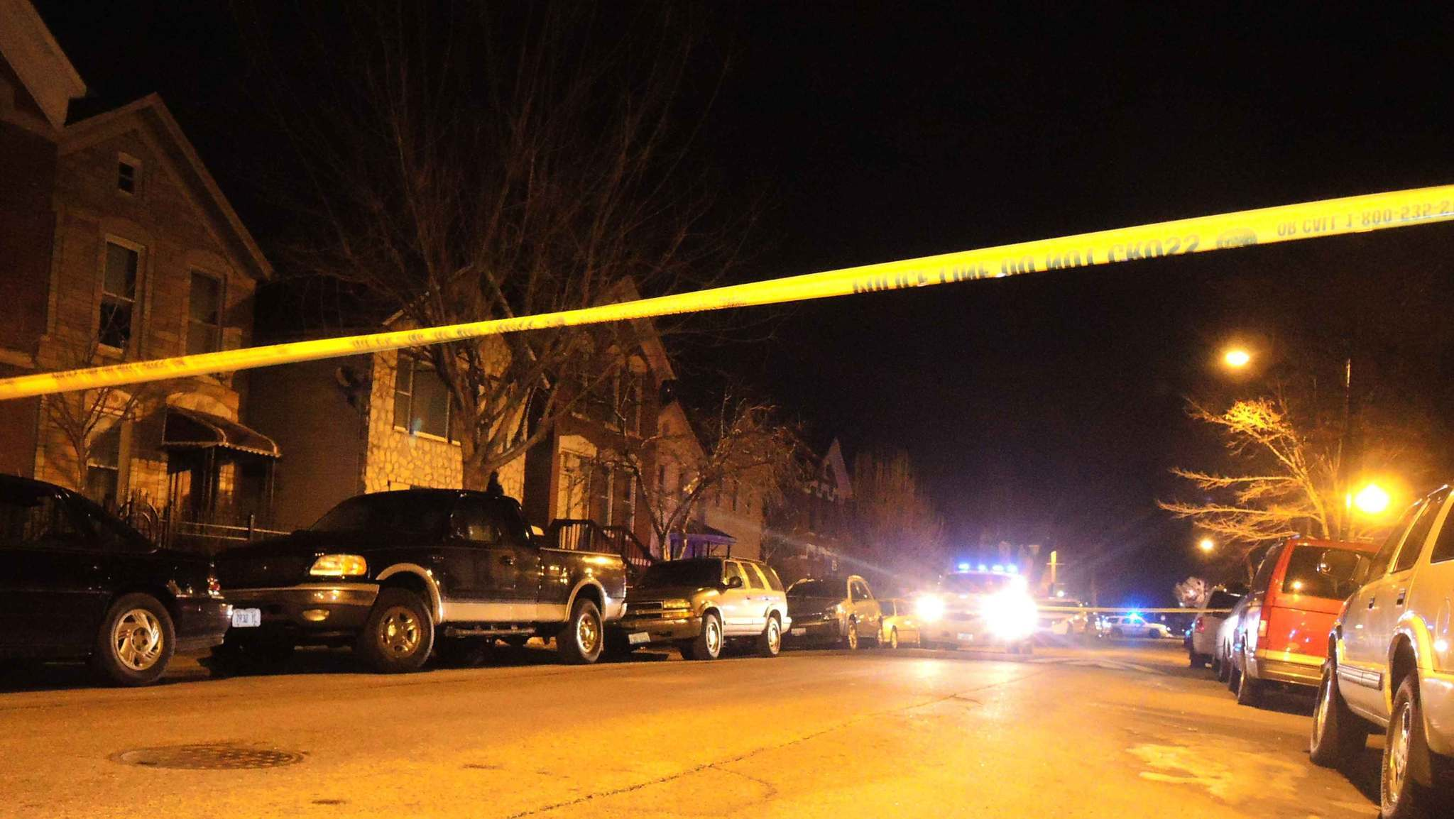Police tape marks the edge of a crime scene after a shooting in the 1600 block of West 21st Place.