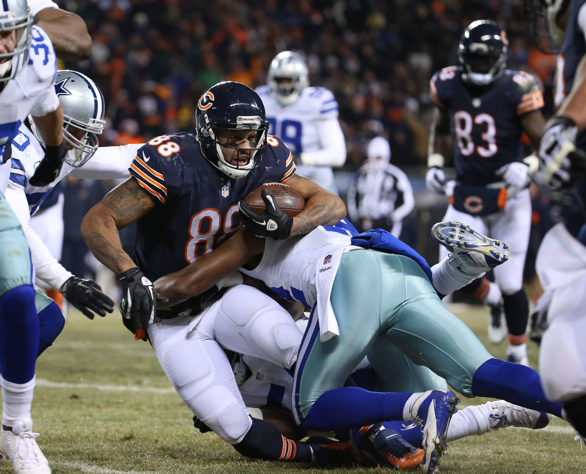 Bears tight end Dante Rosario (88) is brought down by the Dallas Cowboys defense.