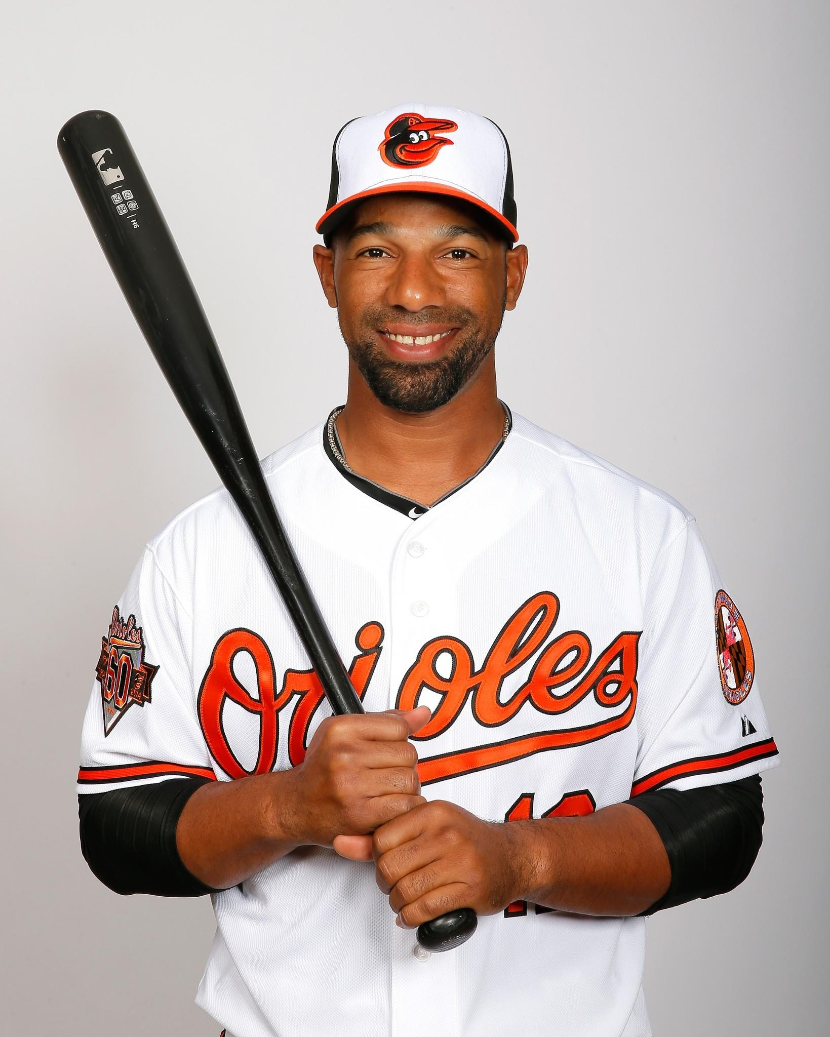 Alexi Casilla #12 of the Baltimore Orioles poses for a portrait on photo day on February 22, 2014 at Ed Smith Stadium in Sarasota, Florida.