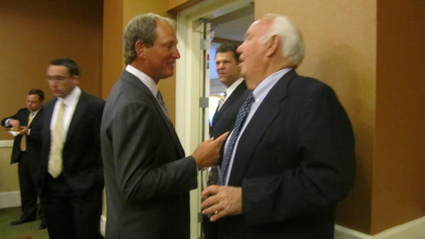UCLA football coach Rick Neuheisel and former USC coach John Robinson talked Tuesday night when Neuheisel was honored as Orange County Youth Sports Foundation Sportsman of the Year.