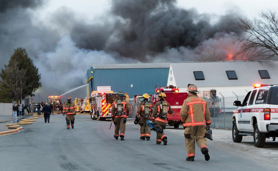 Firefighters respond to the fire at Owl Corp. in Dundalk.