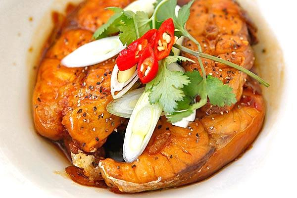 Red-cooked catfish is simmered in a mahogany-colored caramelized fish sauce.