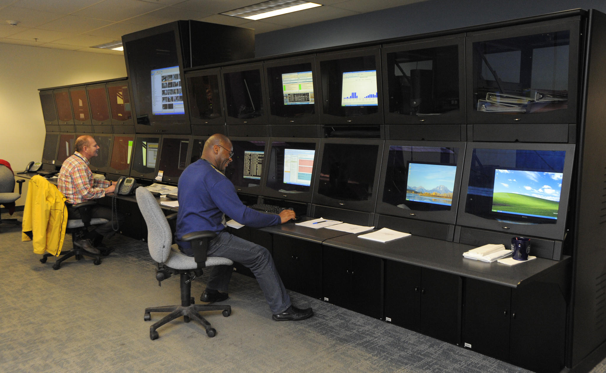 Vince Draper and Jeff McDuffie are Systems Operations Center Technicians at the John's Hopkins Systems Operations Center in Mount Washington. They can monitor physical and environmental conditions at multiple Hopkins sites thoughout the city.