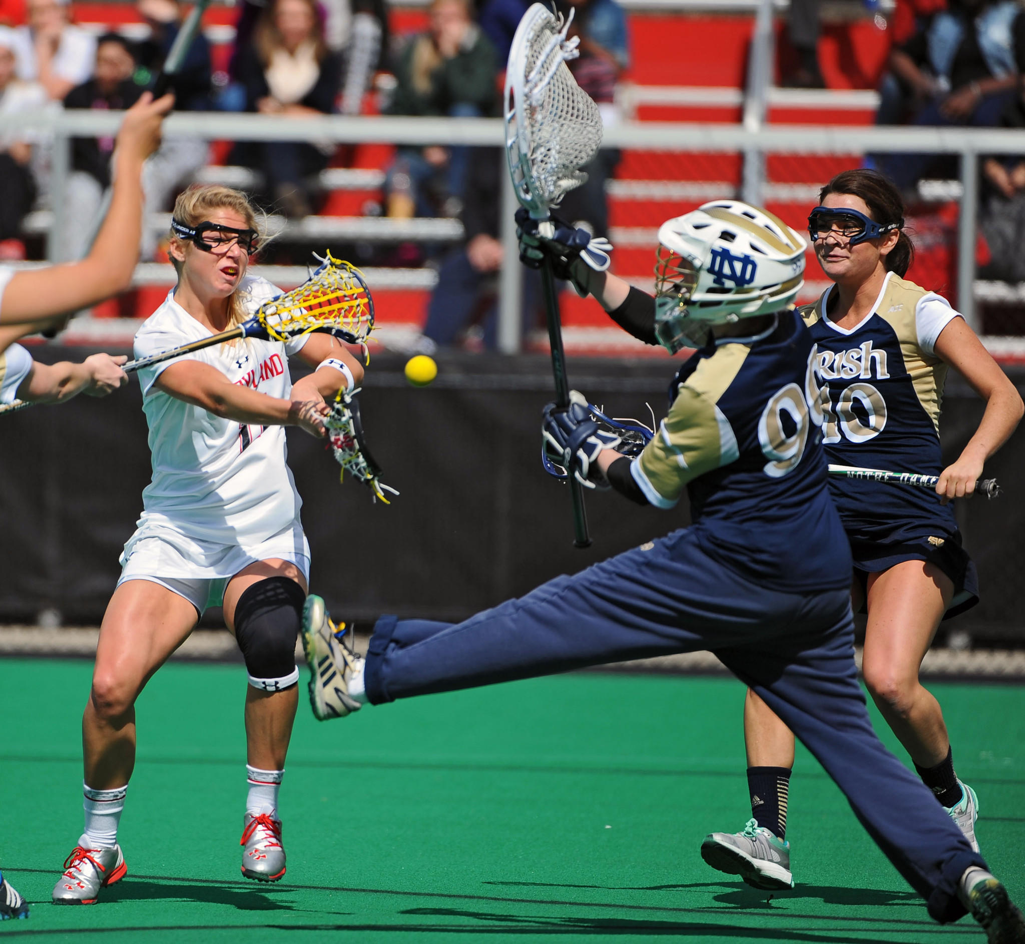 Maryland's Brooke Griffin, left, scores against Notre Dame goalie Allie Murray, right, in the first half.