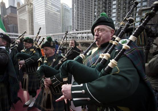The Shannon Rovers Irish Pipe Band plays as the Chicago River is dyed green Saturday.