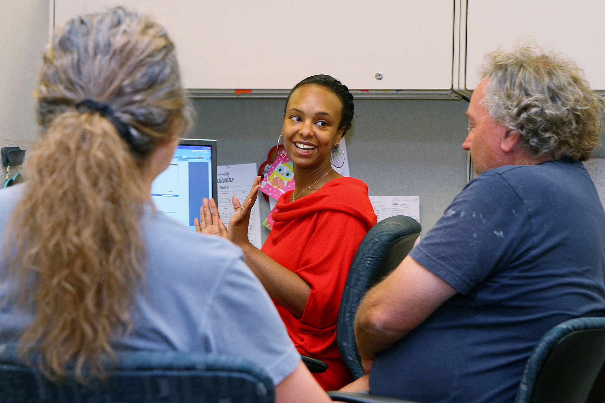 Rasheedah Scott, a case worker with the Community Services & Parks Verdugo Job Center, talks with siblings Jo Marie and Craig McKenzie, of Los Angeles, about Covered California coverage that they are interested in applying for on Friday, March 14, 2014. Scott's daily schedule is filled with approximately hour-long appointments to talk with people about Covered California.