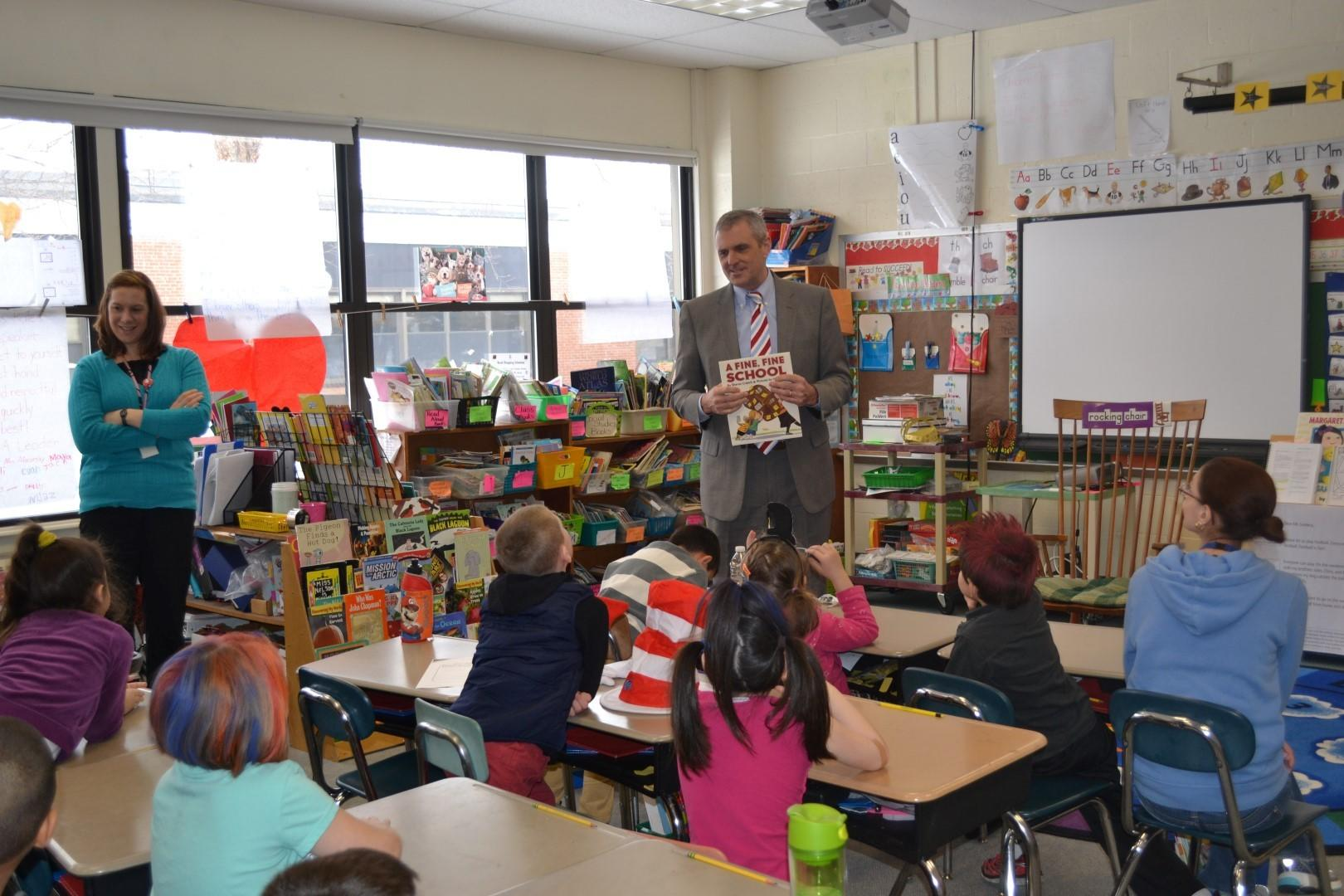 Superintendent of Schools, Dr. Jeffrey Kitching, shares a book with students at Frank T. Wheeler Elementary School as part of the Read Across America celebration.
