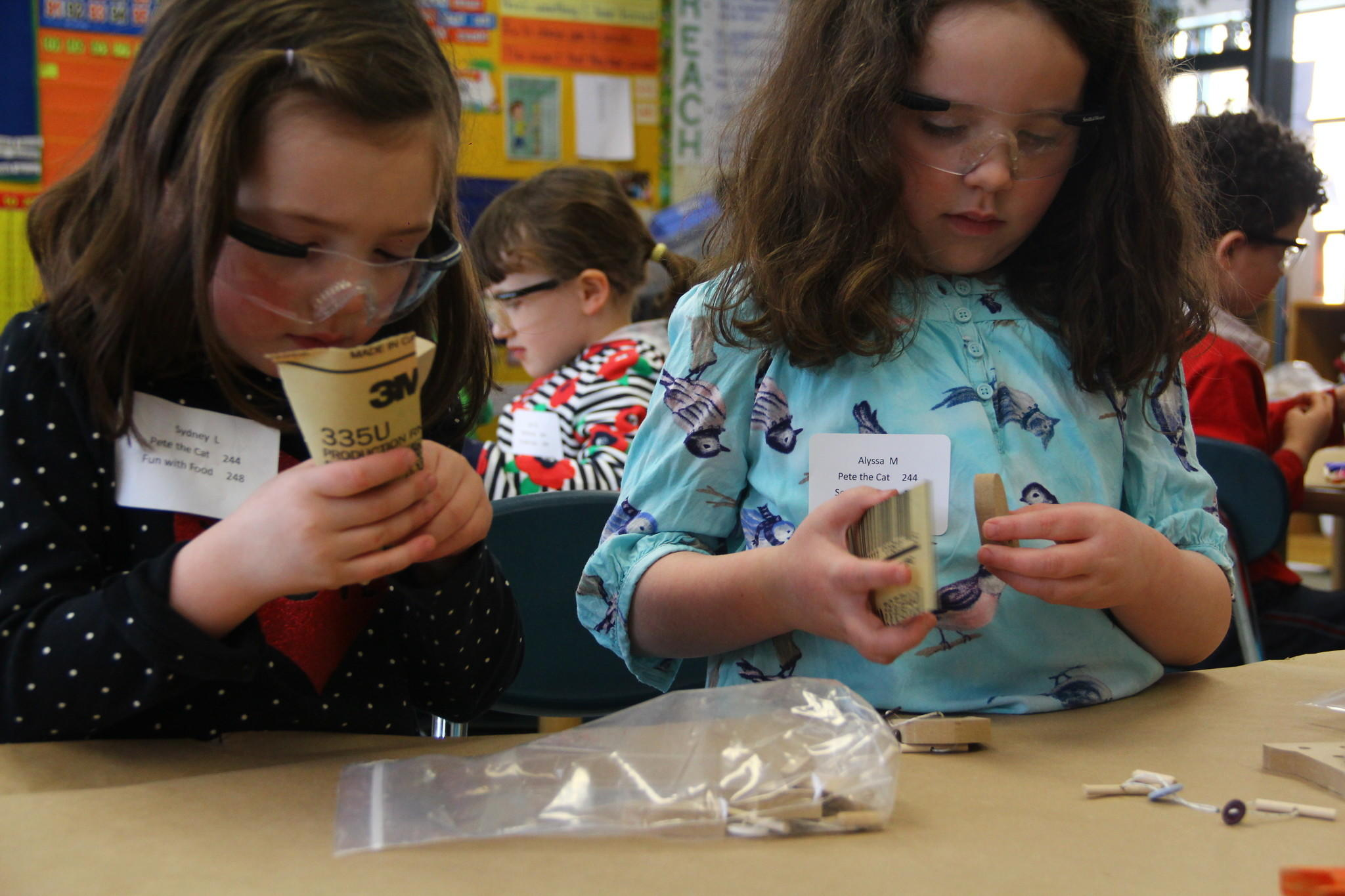 Sydney Liggett and Alyssa Madden participate in a Kindergarten-first grade workshop run by the Eli Whitney Museum at Minds in Motion Middletown.