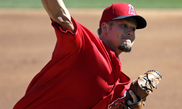 Angels starter Joe Blanton delivers a pitch during a Cactus League game against the Colorado Rockies on March 7. Does Blanton have any chance of making the Angels' opening-day roster?