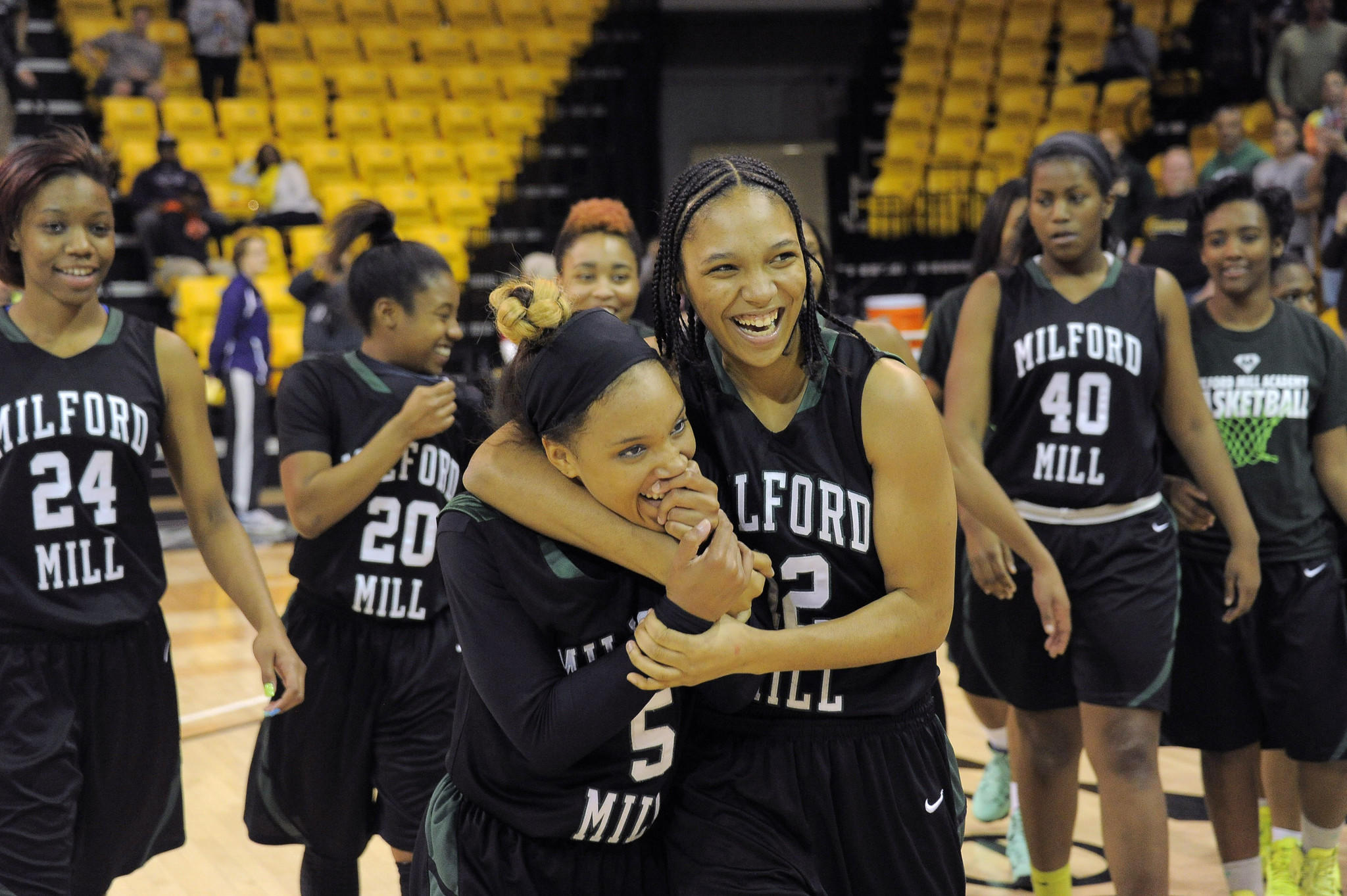 Milford Mill's Kelli Smoot (5) and Deja McKenzie embrace after their Class 3A state championship.
