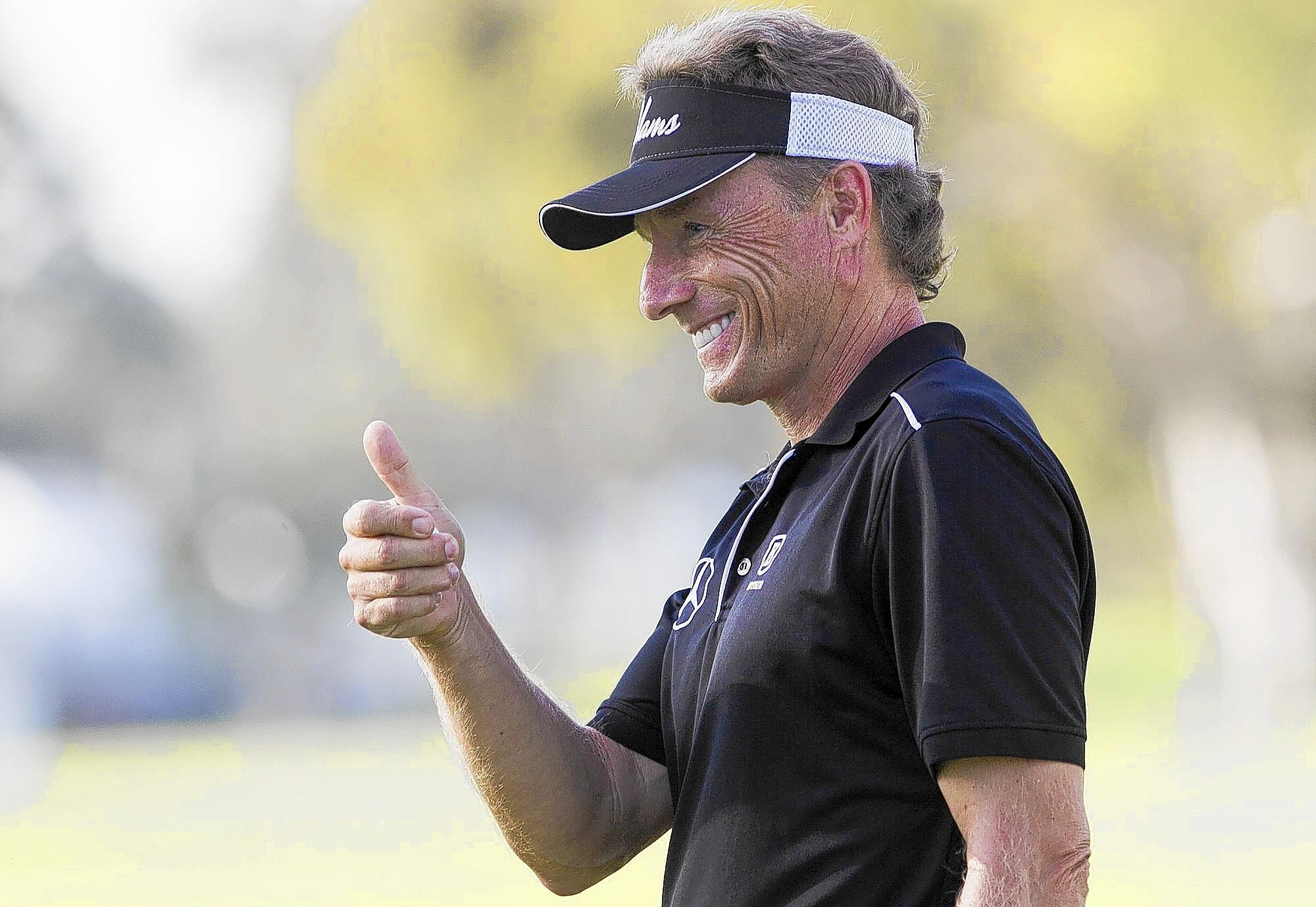 Bernhard Langer gives a thumbs up to the crowd after a birdie on the 15th hole during the second round of the Toshiba Classic on Saturday at the Newport Beach Country Club. Langer enters the final day of the tournament atop the leaderboard with a 13-under-par.