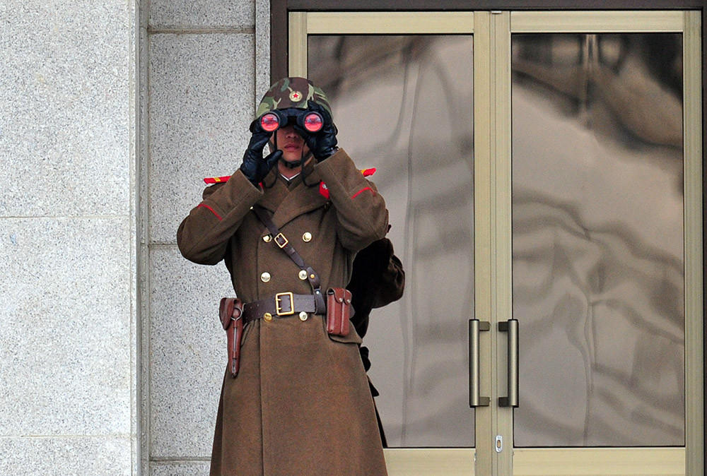 A North Korean soldier looks on at the South side at the truce village of Panmunjom in the Demilitarized Zone dividing the two Koreas on March 12.