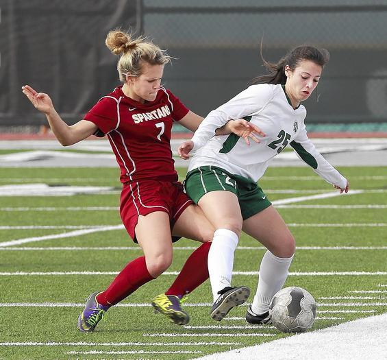 La Caada's Megan Decker, number 7, battles Sage Hill's Alexandra Mowery, 25, in the quarterfinals of the CIF Southern Section Division 5 playoffs at Sage Hill on Monday. (Photo by Don Leach / March 3, 2014)