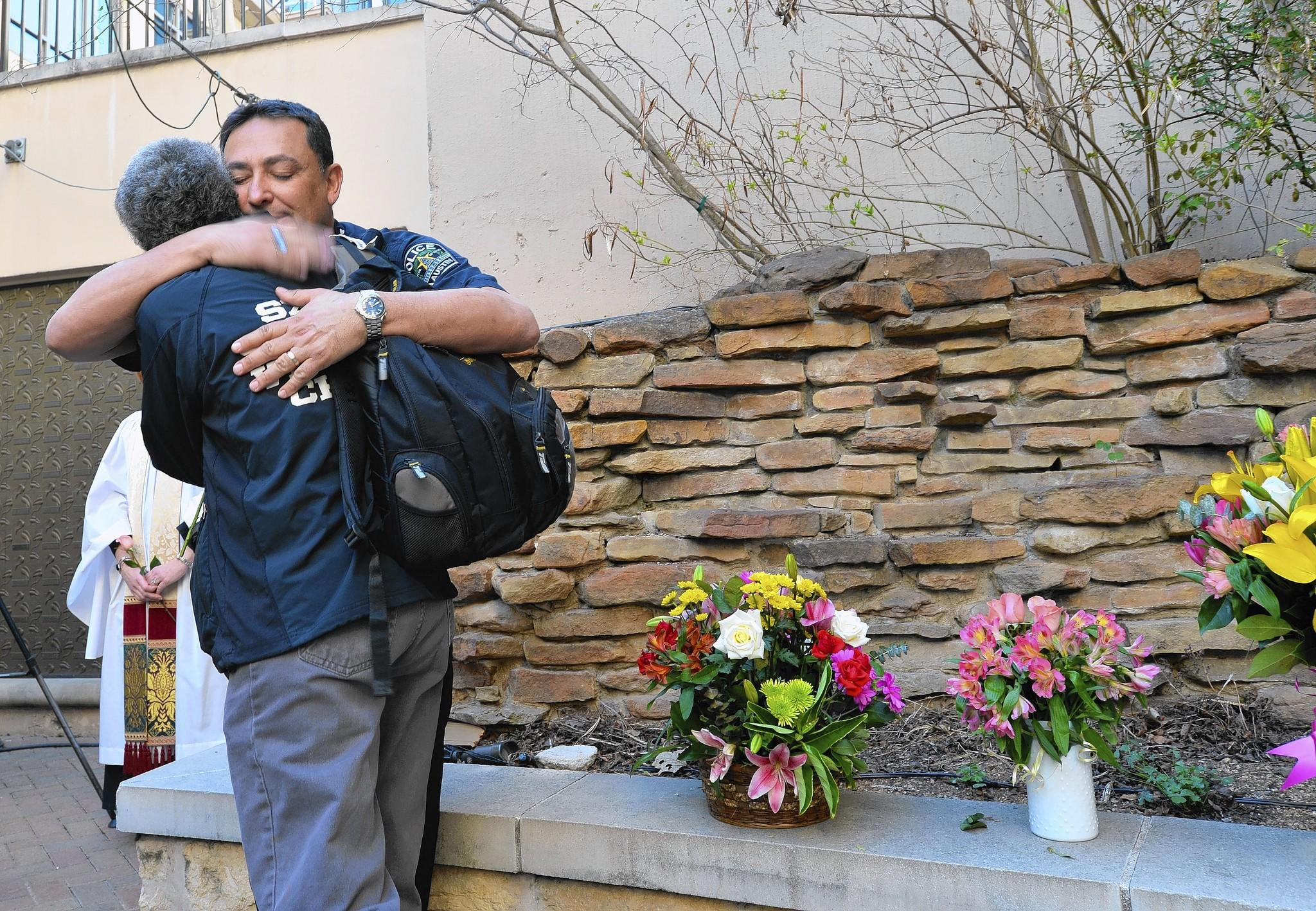 Austin Police Chief Art Acevedo hugs another mourner at prayer service at St. David's Episcopal Church following a deadly car crash at the South by Southwest Music, Film and Interactive Festival (SXSW) on Thursday in Austin, Texas.