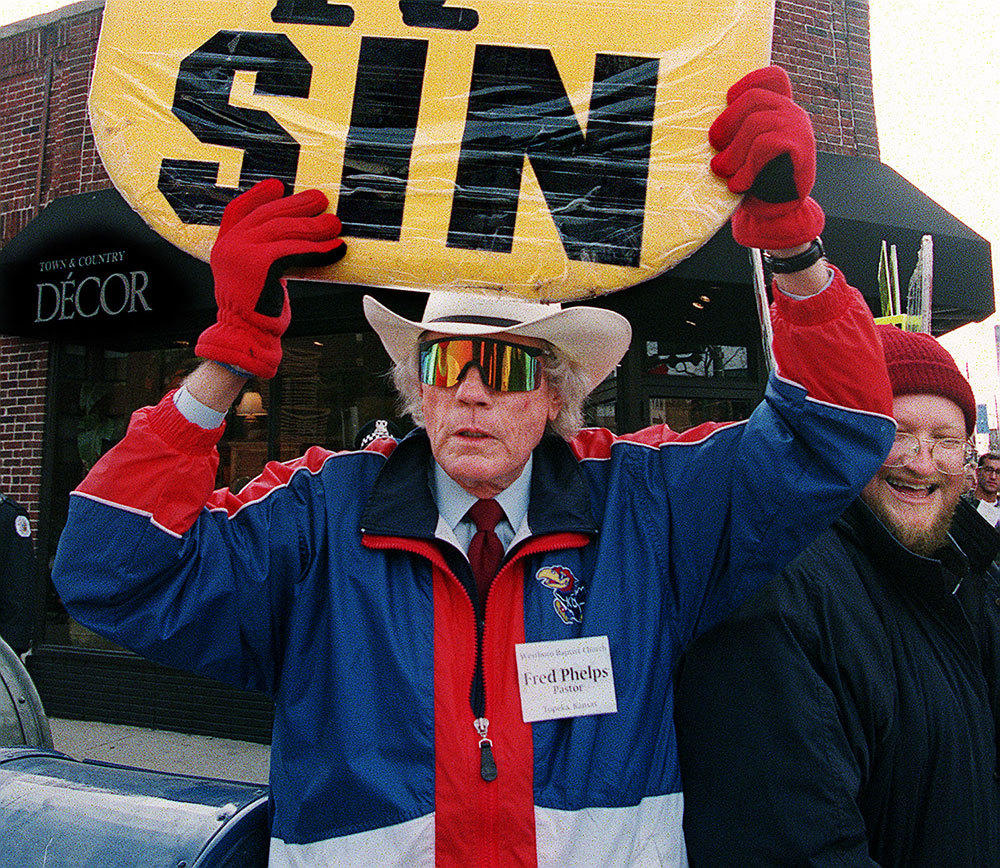 The Rev. Fred Phelps with his son Jonathan (right, smiling) hold an anti-gay protest across the street from the Broadway United Methodist Church Sunday, Nov. 22, 1998.