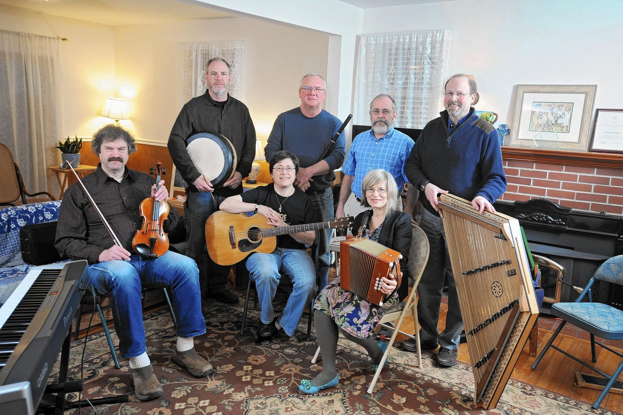 Members of the Tanzania Ceili Band (seated l-r) Ray Lucas, fiddle, Meg Ferguson, guitar, and Claudette Sikora, band coordinator and Irish button accordion. (standing l-r) Norm Myers, Bodhran drum, Martin McCann, wooden flute, Tim Lynch, President of Tanzanian Children's Project, and Harry Ferguson, hammered Dulcimer. The band is rehearsing for one of their up-coming performance at the Wilde Lake Interfaith Center. The traditional Irish band started in 2010 out of the Tanzanian Children's Project to raise funds to support orphans from the African country by building orphanage and medical center.