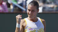 Flavia Pennetta defeats injured Agnieszka Radwanska at Indian Wells