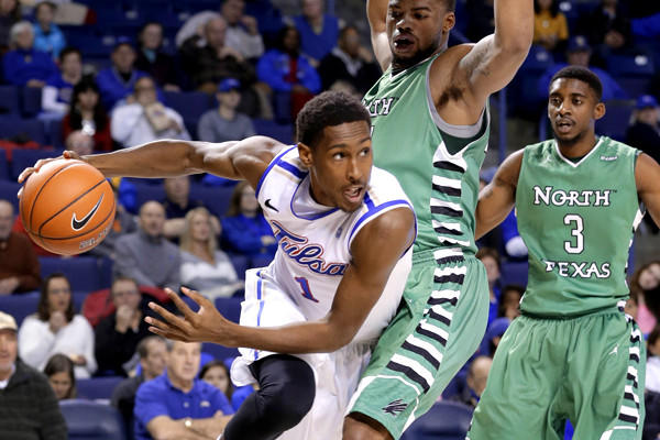 Tulsa forward Rashad Smith drives around North Texas forward Keith Coleman during a game earlier this season.
