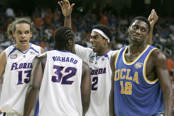 UCLA center Alfred Aboya endures a Florida celebration in the closing moments of a 76-66 loss to Florida in the NCAA Final Four.