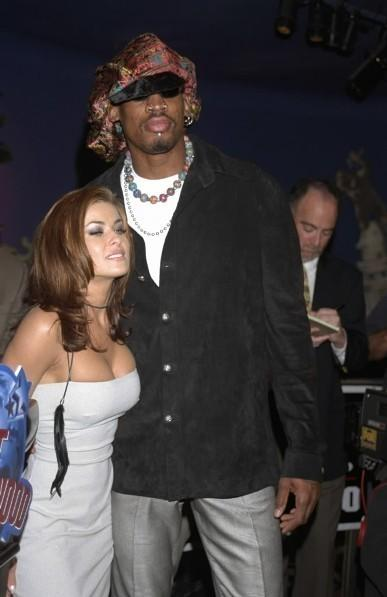 Dennis Rodman (right) with then-wife Carmen Electra (left) during a press conference at the Planet Hollywood restaurant in Hollywood, Calif. in 1999.