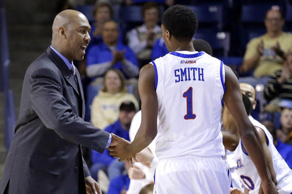 Tulsa Coach Danny Manning welcomes star forward Rashad Smith back to the bench for a breather during a game against North Texas earlier this season.