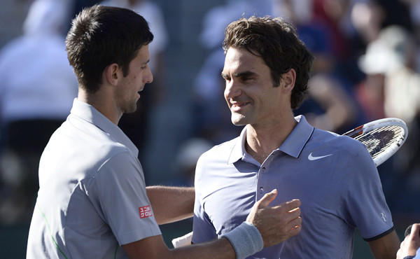 Novak Djokovic, left, is congratulated by Roger Federer after Djokovic's victory in the BNP Paribas Open final at Indian Wells on Sunday.
