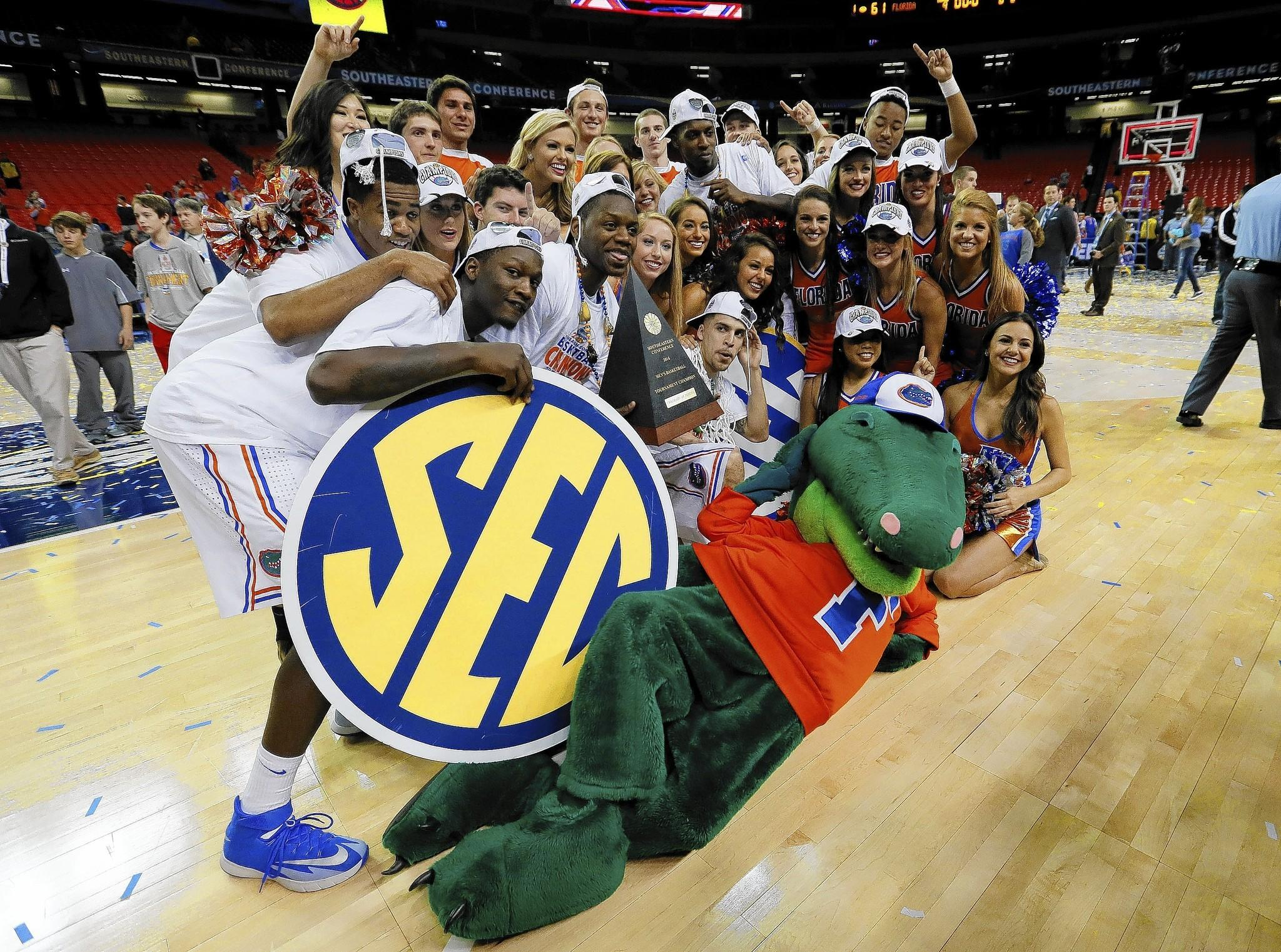 ATLANTA, GA - MARCH 16: The Florida Gators celebrate their 61 to 60 win over the Kentucky Wildcats in the Championship game of the 2014 Men's SEC Basketball Tournament at Georgia Dome on March 16, 2014 in Atlanta, Georgia.