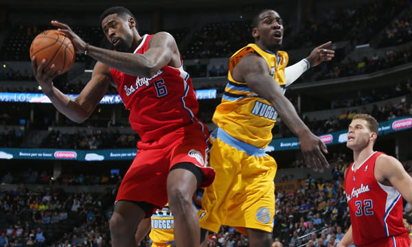Clippers center DeAndre Jordan, left, grabs a rebound next to Denver Nuggets center J.J. Hickson during the Clippers' 116-115 road loss Feb. 3.
