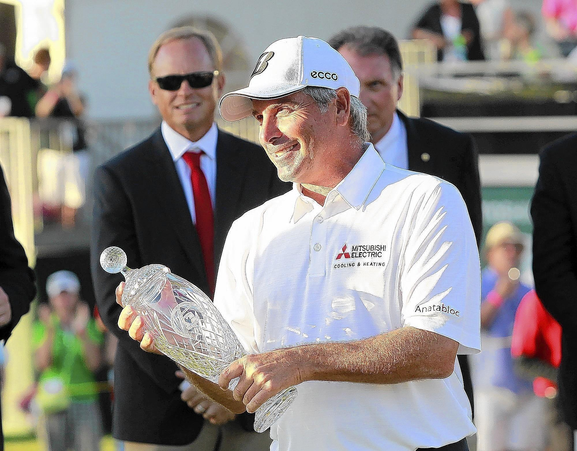 Fred Couples shows off the championship trophy after rising above a crowded leaderboard at the 2014 Toshiba Classic final round on Sunday.