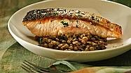 Recipe: Crisp-skinned salmon with lentils, bacon and dandelion greens