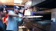 Sighting: WWE's CM Punk cooks his own pizza at Ian's