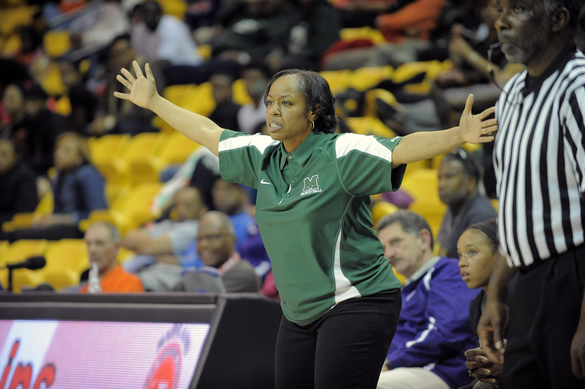 DeToiya McAliley coaches her team during the state semifinals.