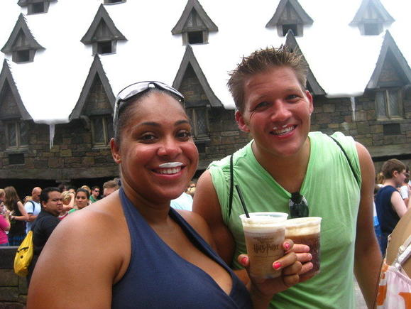 Stephanie Brown, left, and friend Louie Lee down some Butterbeer at the Wizarding World of Harry Potter