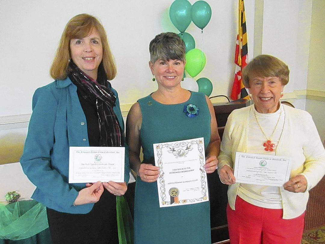 The Joppatowne Garden Club received three awards at the recent District III Annual Meeting at Hillendale Country Club. Pictured, from left, are Sara Perkins with the Mae Scott Tapestry Landscape Award for the landscape of the brick wall in the median strip in Joppatowne; President Sophia Montgomery with a certificate for increased membership; and Ellie Pfoutz with a certificate of recognition for flower shows.