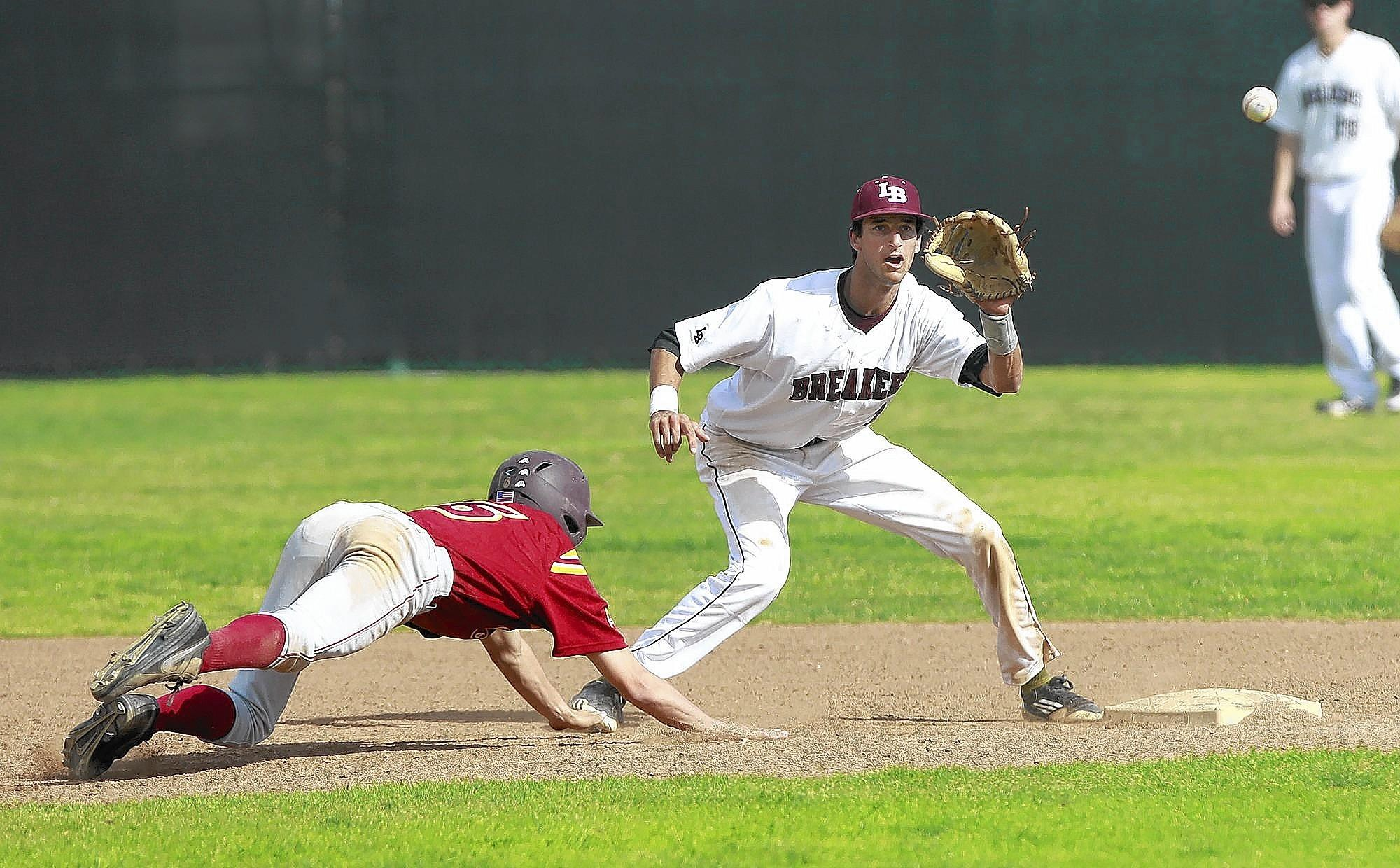 Laguna Beach High shortstop Preston Grandpre prepares to gag the Ocean View baserunner out, during Tuesday's game at Laguna Beach High.