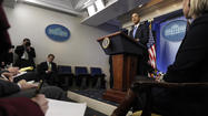 Obama warns Russia of more sanctions if it doesn't back down in Crimea