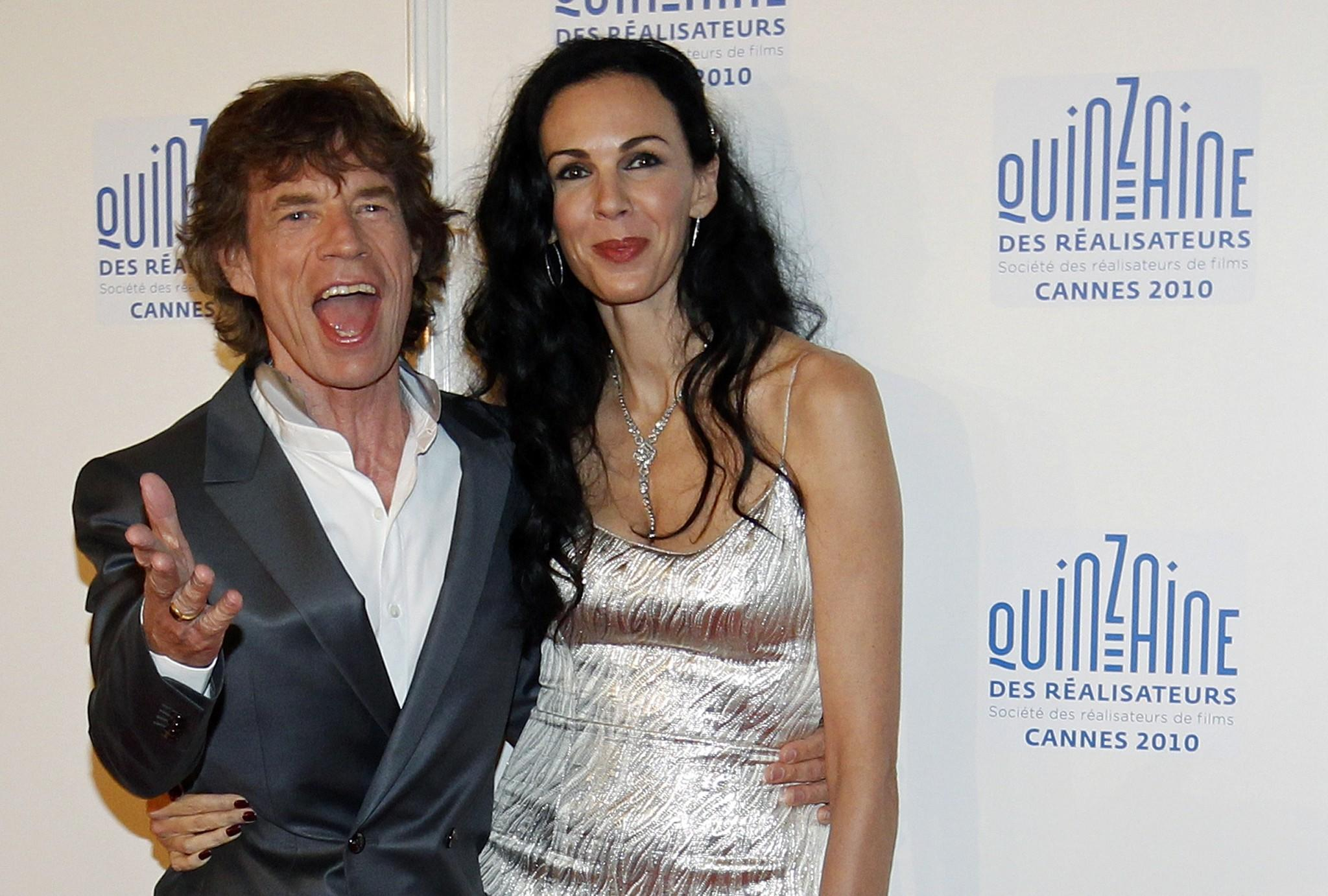 "Mick Jagger and fashion stylist L'Wren Scott arrive at the ""Quinzaine des Realisateurs"" at the 63rd Cannes Film Festival in 2010."