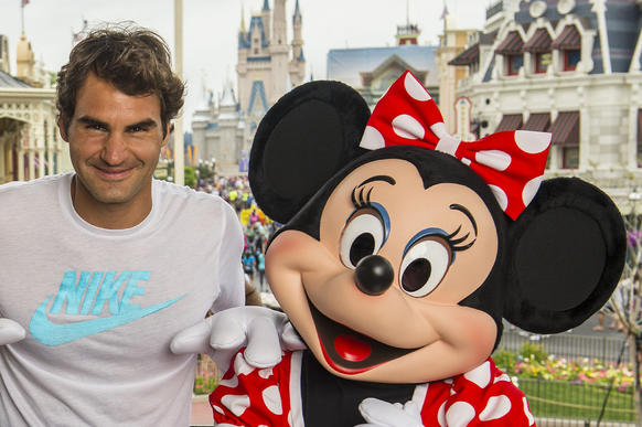 Tennis legend Roger Federer poses with Mickey and Minnie Mouse at the Magic Kingdom on March 17, 2014. Federer holds the men's world record for most Grand Slam tournaments won, 17, and has spent 302 weeks as the world's No. 1-ranked male tennis player. Federer is competing in the Sony Open in South Florida this week.