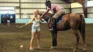 Academic program helps city students try polo in the county