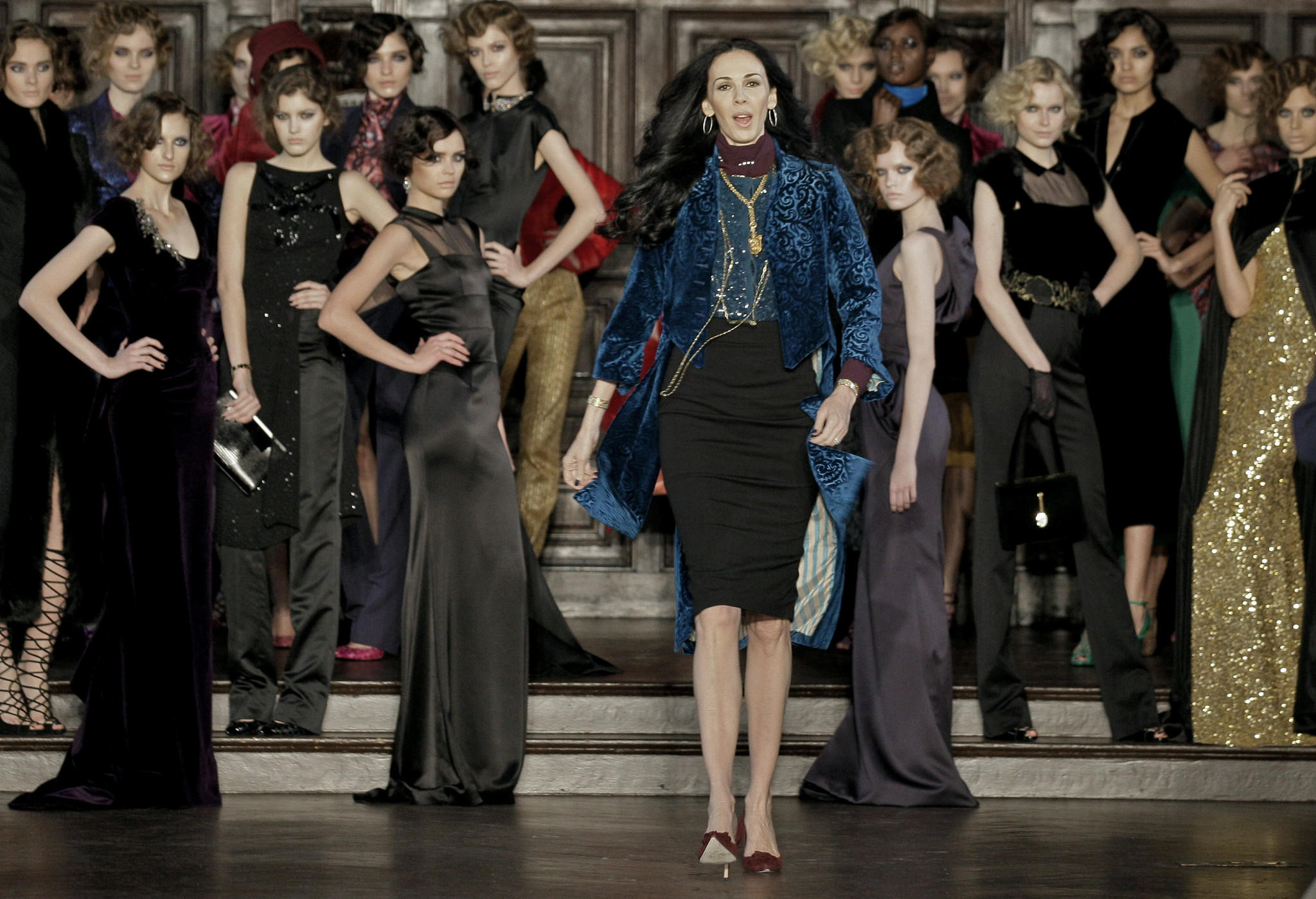 Designer L'Wren Scott, center, shown after her Fall 2012 collection was modeled during Fashion Week, in New York, was found dead Monday, March 17, 2014, in Manhattan of a possible suicide.