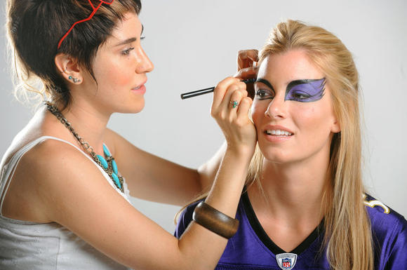 Leah Sarah Bassett works on model Haley Higgins to achieve the Ravens-meet-'Black Swan' look.